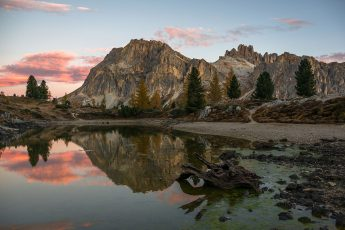 Autumn scenery by the lake Limides in Dolomites mountains.