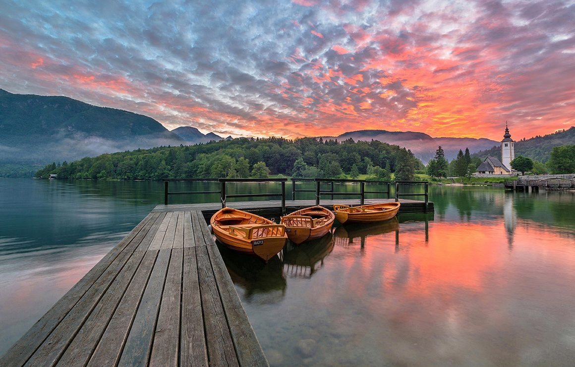 Beautiful Bohinj lake on a vivid sunrise