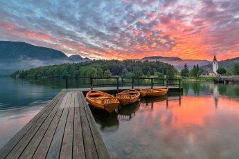 Beautiful Bohinj lake on a vivid sunrise
