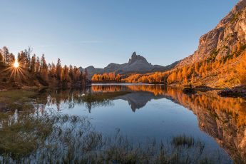Amazing autumn scenery in the Dolomites mountains at Lake Federa.