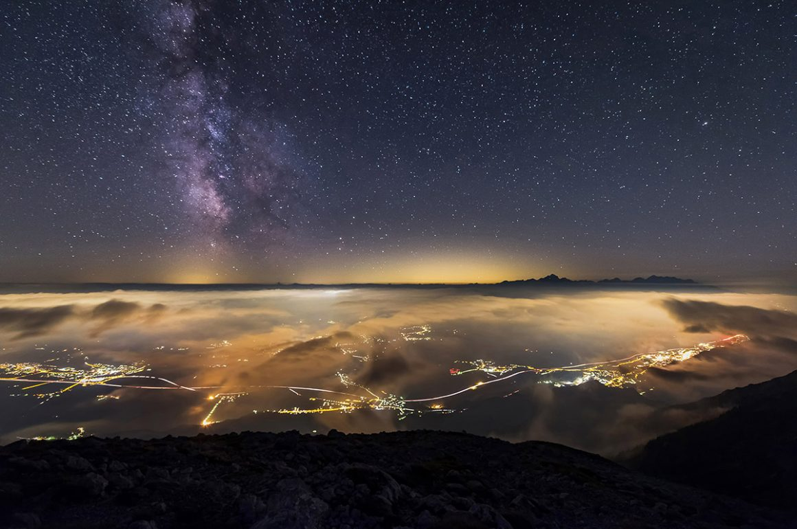 Milky way over Triglav and towns Jesenice and Bled