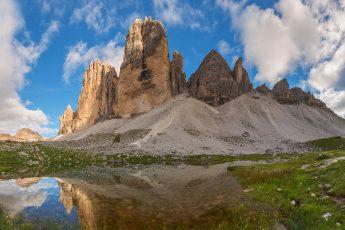 Mountain reflection in lake by Tre Cime di Lavaredo in Dolomites
